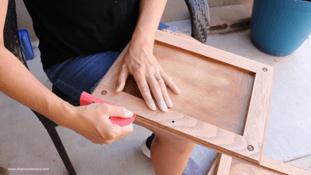Hand sand the doors